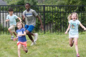 Kids running playing tag