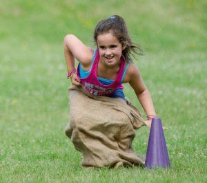 Girl playing in potato sack race