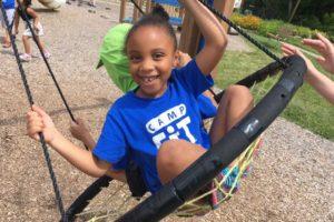 Girl smiling on swing