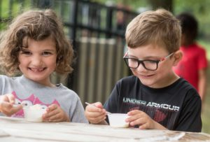 Young boy and girl eating ice cream together