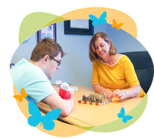 Nicole Gerami playing chess with child